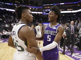 Friends since high school, De'Aaron Fox and Donovan Mitchell continue to  ascend in the NBA - Deseret News