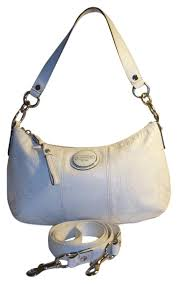 purses and white patent leather satchel