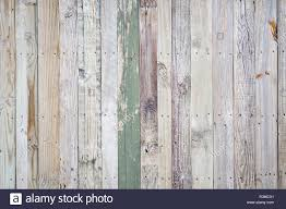 Rustic Weathered Wooden Fence Background With Rough Imperfections And Peeling Paint On Wood Grain Texture Stock Photo Alamy