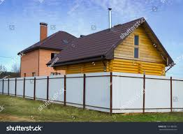 Brick House Wooden House Behind High Stock Photo Edit Now 137180930