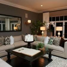beige couch cream grey pattern rug