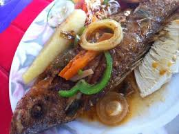 brown stew fish with yam breadfruit