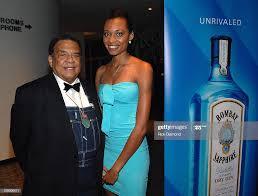 Former Mayor Andrew Young poses with Bombay Sapphire Girl, Latasha ...