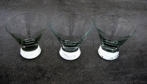 three inverted cone bowl glasses on a