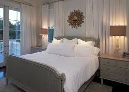 gray cane bed with footboard dressed