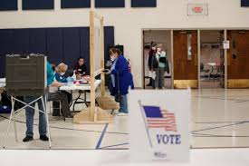 Wisconsin voters are waiting in long ...