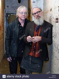 Mike Mills (left) and Michael Stipe of R.E.M pose following a Q&A ...