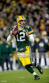 Aaron Rogers of the Green Bay Packers looks for an open receiver... News  Photo - Getty Images