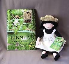 cloth doll and hardcover book