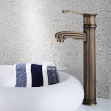 antique brass bathroom faucet carved