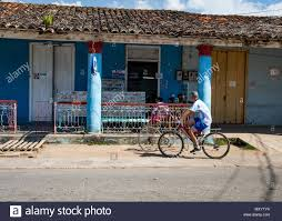 A cyclist passes a video store in Vinales Cuba Stock Photo - Alamy
