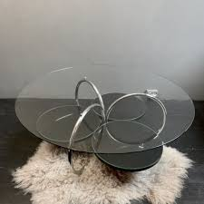 round brown coffee table with shelf