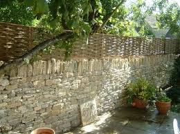 Fence On Top Rock Wall Willows Traditional Woven Willow Hurdle Fencing Used In Many Projects Stone Walls Garden Dry Stone Wall Outdoor Stone
