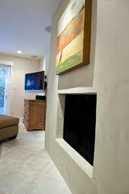 stucco fireplace surround