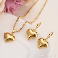 heart pendant necklace earrings