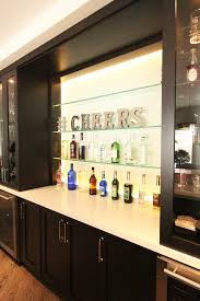 glass shelves in bar with back painted