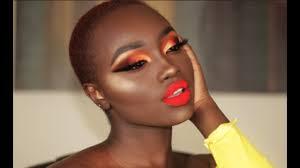bold lips dark skin makeup look