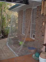 Jenny And Graeme Have A New Kitten They Named Jade And Wanted To Build A Cat Enclosure In An Area Under The E Cat Fence Outdoor Cat Enclosure Diy Cat Enclosure