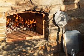an outdoor fireplace pizza oven