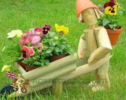 wheelbarrow planter standing boy or