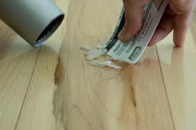 remove candle wax from hardwood floors