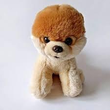 cutest dog pomeranian plush sitting