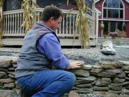 build a dry stack stone retaining wall