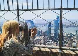 Girl Looking Out At New York City From The Empire State Building Mini Adventures