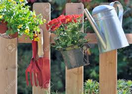 Gardening Tools And Flower Pot Hanging On A Fence Stock Photo Picture And Royalty Free Image Image 22658952