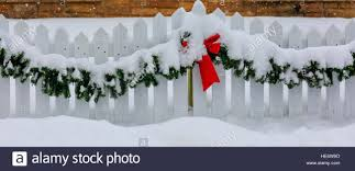 White Picket Fence Decorated For Christmas With Red Bow And Green Stock Photo Alamy