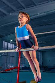 sports gymnastics on a parallel bars