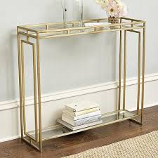 brass fretwork details glass console