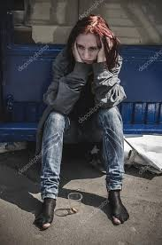 sad in old torn dirty clothes and