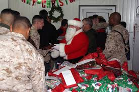 hands out gifts to u s