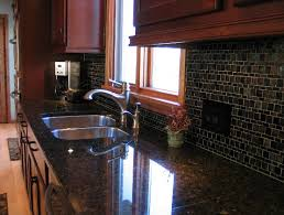cherry kitchen cabinets with gray wall