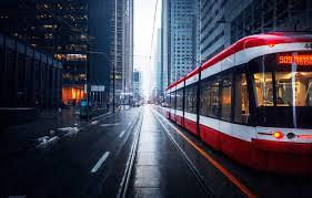 rain buildings skysers tram