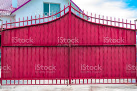 Steel Rusty Gates And A Red Brick Fence Stock Photo Download Image Now Istock