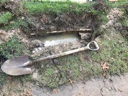 crushed black corrugated drainage pipe