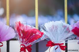 The Bouquets Of Flowers Wrapped In White Pink And Red Paper Tied With A Beautiful Red