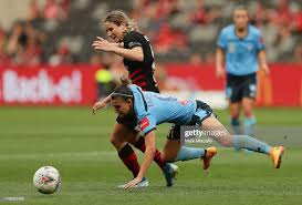 Chloe Logarzo of Sydney FC is tackled by Courtney Nevin of the... News  Photo - Getty Images