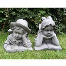 stone effect boy and girl laying