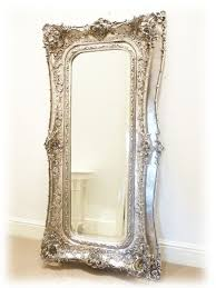 a full length mirror beside the piano