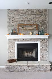 fireplace gray walls white mantel