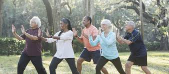 Multi-ethnic group of seniors taking tai chi class | NCOA