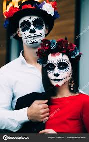 couple wearing skull make all souls