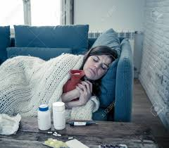 Sick Attractive Woman With Hot Water Bottle Lying On Sofa At.. Stock Photo,  Picture And Royalty Free Image. Image 129253918.