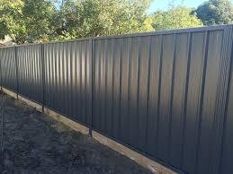 20 Gorgeous Black Wooden Fence Design Ideas For Frontyards Coodecor Fence Design Unique Fence Ideas Backyard Fences