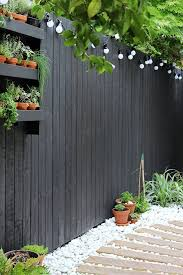 modern garden with black fencing and
