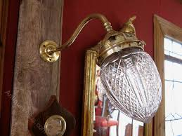 wall light with cut glass shade