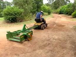 road grader with ride on mower you